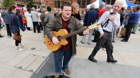 Street busker Fearghus Butler performs in Derry city centre with record attendances on the streets. Photograph: Paul Faith/PA Wire