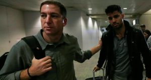 Journalist Glenn Greenwald (L) walks with his partner David Miranda in Rio de Janeiro's International Airport today. Photograph: Ricardo Moraes/Reuters