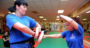 Ciara O' Brien, right, wearing the Jawbone Up wristband, sparring with Evette Wade at the kickboxing class, at Bushido Martial Arts Academy, Clondalkin. Photograph: Eric Luke