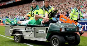 Limerick's Séamus Hickey is removed from the field after injuring his cruciate ligament on Sunday.  Photograph: James Crombie/Inpho