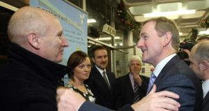 Billy Hutchinson of the Progressive Unionist Party welcomes the Taoiseach, Enda Kenny, to Belfast in 2011. Mr Hutchinson has become involved with an initiative exploring loyalist culture and identity. Photograph: PA