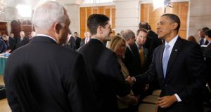 Barack Obama greeting lawmakers during  a bipartisan meeting to discuss health reform legislation in Washington in 2010.  Photograph: Jason Reed/Reuters
