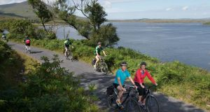 Frank McNally at Mulranny during his Great Western Greenway cycle from Westport to Achill, along with Anna O'Connor, Mayo County Council's walking and cycling officer. Photograph: Michael McLaughlin