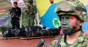 Colombian soldiers guard the bodies of Farc guerillas in Popayan earlier this month. Photograph: Jaime Saldarriaga