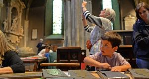 Koen Mehta, from Minissota in the United States, takes part in brass-rubbing at St Patrick's Cathedral, Dublin, as part of National Heritage Week. Photograph: Dara Mac Dónaill