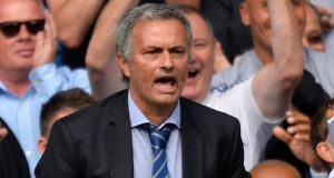 Chelsea's Jose Mourinho reacts after his side had scored against Hull City on the opening day of the Premier League season.