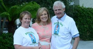 Mary Kennedy (centre) chairman of the judges of the Rose of Tralee   with Elma and Fionbarr Walsh, the parents of the late Donal Walsh.