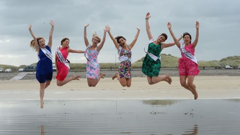 Roses in the air: Boston and New England Rose Deirdre Buckley, Longford Rose Aisling Farrell, New Orleans Rose Molly Molloy Gambel,  Philadelphia Rose Brittany Killion, New Zealand Rose Judeena Carpenter and Queensland Rose Sorcha Holmes take the air at Banna Strand, Co Kerry, during the Rose of Tralee festival. Photograph: Domnick Walsh/Eye Focus