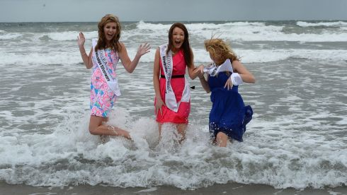 Braving the seas in Kerry during the Rose of Tralee festival were New Orleans rose Molly Molloy Gambel, Longford rose Aisling Farrell and Boston and New England rose Deirdre Buckley, at Banna Strand, Co Kerry. Photograph: Domnick Walsh/Eye Focus