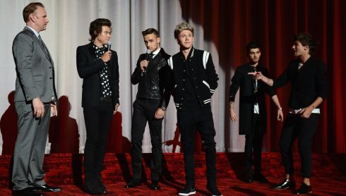 "LONDON, ENGLAND - AUGUST 20:  (L-R) Director Morgan Spurlock, Harry Styles, Liam Payne, Niall Horan, Zayn Malik and Louis Tomlinson from One Direction speak on stage ahead of the ""One Direction This Is Us"" world premiere at the Empire Leicester Square on August 20, 2013 in London, England.  Photograph: Ian Gavan/Getty Images"