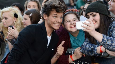 Louis Tomlinson from One Direction meeting fans in Leicester Square.  Photograph: by Ian Gavan/Getty Images for Sony Pictures