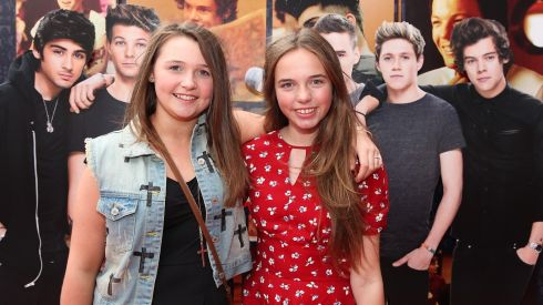 Aoife Caulfield (12) and Nadia Beshoff(13) from Howth, Dublin at the Cineworld screeing of One Direction: This is Us. Photograph: Bryan Brophy/1Image
