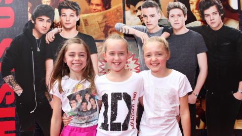 Kerry (8) and Aisling (10) Cullen and Claire Finn (10) from Dublin at the Cineworld screeing of One Direction: This is Us. Photograph: Bryan Brophy/1Image
