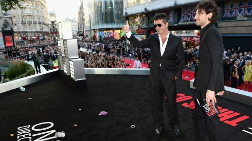 "Simon Cowell attends the ""One Direction This Is Us"" world premiere Photograph: Ian Gavan/Getty Images"