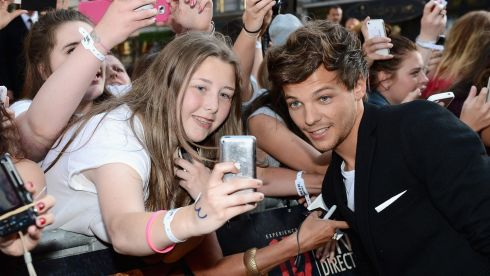 Singer Louis Tomlinson meets fans. Photograph: Ian Gavan/Getty Images