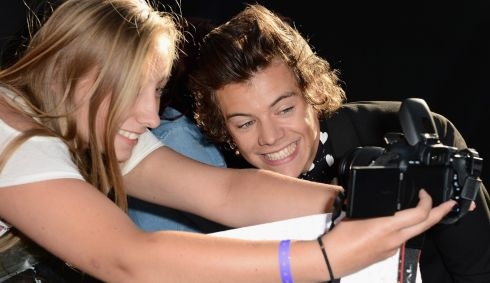 Harry Styles poses with fans. Photograph: Ian Gavan/Getty Images