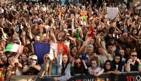 Fans gathering for the red carpet arrival of One Direction in Leicester square. Photograph: Ian Gavan/Getty Images