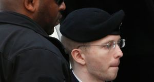 Bradley Manning is escorted into court to receive his sentence at Fort Meade in Maryland today. Manning, who was convicted of the biggest breach of classified data in the nation's history, was sentenced to 35 years in jail. Photograph: Reuters