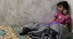 A girl who survived the apparent gas attack rests inside a mosque in the Duma neighbourhood of Damascus today. Britain and France are to request a United Nations investigation into the  alleged chemical attack. Photograph: Mohamed Abdullah/Reuters