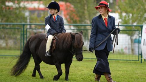 Jeanette Abbott and Lucie Anne Abbott, on Winnie Winn at the 72nd Virginia Show, in Co. Cavan on Wednesday. Photo: Dara Mac Donaill / THE IRISH TIMES