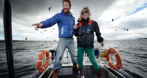 Al Mennie and Fionola Meredith on a boat tour of the Co Antrim coast. Photograph: Charles McQuillan/Pacemaker