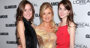Arianna Huffington with her daughters Christina and Isabella. Photograph: Dimitrios Kambouris/WireImage