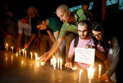 Lebanese and Syrian civilians take part in a candlelight vigil in solidarity with Syrian civilians killed by a gas attack in the suburbs of Damascus, in front of the offices of the UN headquarters in Beirut. Photograph: Mohamed Azakir/Reuters