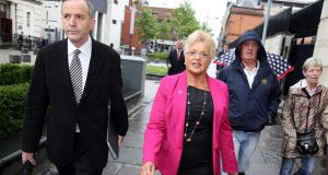 Democratic Unionist councillor Ruth Patterson, with her solicitor Denis Moloney, arriving at Belfast Magistrates Court today in connection with a comment she posted on Facebook. Photograph: Paul Faith/PA Wire