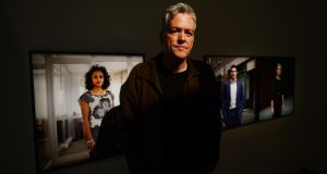 On the market: Mark Curran with three of his portraits of traders at the Gallery of Photography in Dublin. Photograph: Alan Betson/The Irish Times