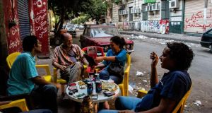 People gather on the street in Cairo. Photograph: Bryan Denton/The New York Times