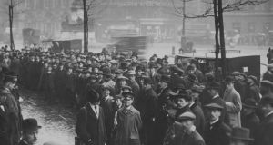 Locked out: crowds of workers waiting for Jim Larkin in Dublin. Photograph: Hulton Archive