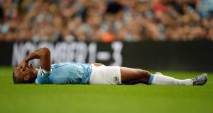 Manchester City's Vincent Kompany lies injured during the Barclays Premier League match against Newcastle United. Photograph: Martin Rickett/PA Wire