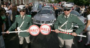Team Polizei 'officers' at the start of Cannonball 2010 which saw over 160 of the worlds finest cars line up to start a three-day tour of Ireland in aid of Barretstown. Photograph: Alan Betson/The Irish Times