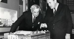 Frank O'Reilly (left) at a reception to announce building plans in TCD in 1988 with then  provost Dr WA Watts