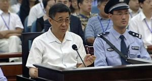 Bo Xilai, left,  speaks to Jinan intermediate people's court during his corruption trial.  Photograph: video via AP