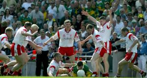Tyrone defenders swarm around a Kerry player during the 2003 All-Ireland semi-final at Croke Park. Tyrone won 0-13 to 0-6 and went on to defeat Armagh in the final. Photograph: Morgan Treacy/Inpho