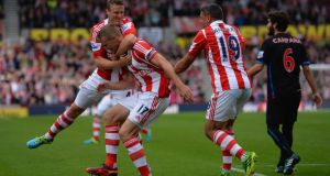 Ryan Shawcross of Stoke (centre) celebrates scoring with Robert Huth (left) and Jonathan Walters at Britannia Stadium. Photograph:  Christopher Lee/Getty Images
