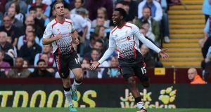 Liverpool's Daniel Sturridge (right) celebrates after scoring the winner at Villa Park. Photograph:  Nick Potts/PA Wire