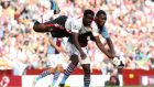 Liverpool's Kolo Toure (left) and Aston Villa's Christian Benteke  battle for possession at Villa Park. Photograph: Nick Potts/PA Wire