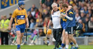 Clare's Aaron Cunningham is helpedfrom the field after sustaining a  hamstring injury in their win over Galway at Semple Stadium. Photograph: Stephen McCarthy/Sportsfile