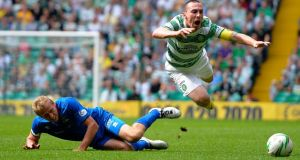 Celtic's Scott Brown (right) is challenged by Inverness Caledonian Thistle's Richie Foran at Celtic Park. Photograph: Russell Cheyne/Reuters