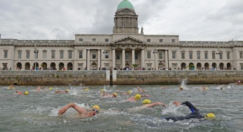 Competitors pass the Custom House  the 94th Dublin City Liffey Swim supported by Dublin City Council and staged by The Open Sea  Committee at the weekend. Photo: Dara Mac Donaill / THE IRISH TIMES