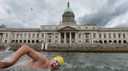 James Scallon, NAC Masters, passing the Custom House during the 94th Dublin City Liffey Swim supported by Dublin City Council and staged by The Open Sea  Committee at the weekend. Photo: Dara Mac Donaill / THE IRISH TIMES
