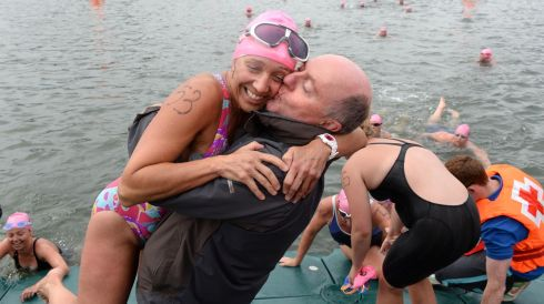 Gina Murphy, Glenalbyn Masters, winner of the womens race is congratulated by her husband Kevin Murphy, at the 94th Dublin City Liffey Swim supported by Dublin City Council and staged by The Open Sea  Committee at the weekend. Photo: Dara Mac Donaill / THE IRISH TIMES            Dara Mac Donaill  Dara MacDonaill