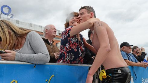 Philip Power, Viking, congratulted after finishing the 94th Dublin City Liffey Swim supported by Dublin City Council and staged by The Open Sea  Committee at the weekend. Photo: Dara Mac Donaill / THE IRISH TIMES