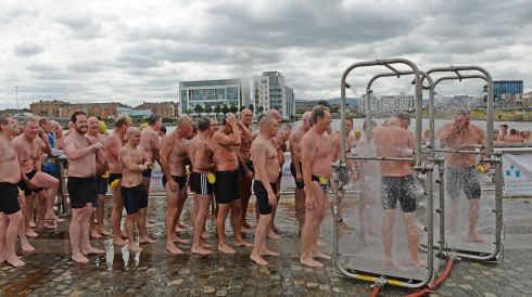 Showering at the end of the 94th Dublin City Liffey Swim at the weekend. Photo: Dara Mac Donaill / THE IRISH TIMES