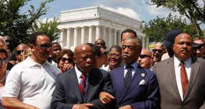 The Rev Al Sharpton (second right) links arms with Georgia Democratic representative John Lewis next to Martin Luther King III (right) as they begin to march.  Photograph: Kevin Lamarque/Reuters