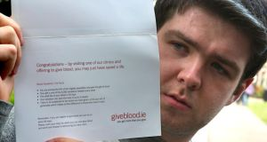 Tomas Heneghan shows a congratulation card which he received for a blood donation. Photograph: Joe O'Shaughnessy.