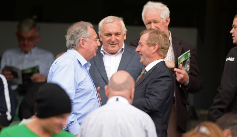 Taoiseach Enda Kenny TD  chats with Minister Pat Rabbitte TD as former Taoiseach Bertie Ahern and brother Maurice go past at Tyrone v Mayo during the All Ireland senior football championship semi-final at Croke Park. Photo: Dara Mac Donaill / THE IRISH TIMES