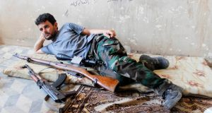 A Free Syrian Army fighter rests next to his weapons in al-Swaika district in Aleppo at the weekend. Photograph: Molhem Barakat/Reuters
